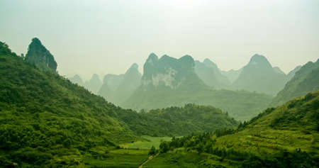 Glorious Karst Formation Covered with Lush Greenery and the Twilight photo