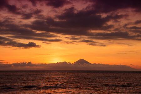 fata morgana: Awesome sunset featuring sea water and volcano Stock Photo