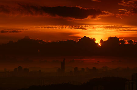 Stunning golden-red sunset above the metropolis photo
