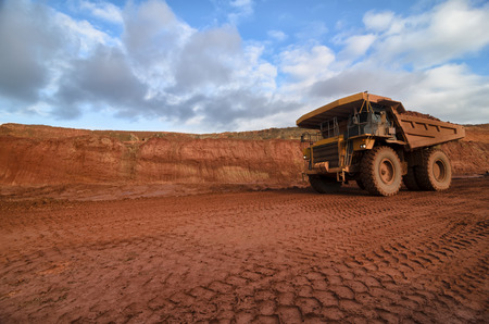 open pit: Closeup of a loaded yellow truck in an open pit Stock Photo