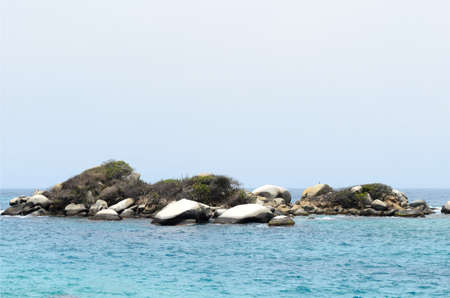 Little island and blue sea water Stock Photo