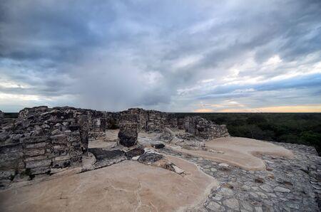 pyramid peak: Top of Mayan pyramid under tragic stormy sky