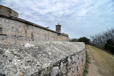 tragic: Wall of an ancient  under tragic cloudy sky