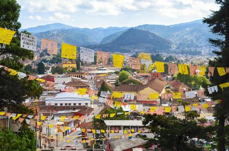 cristobal: Aerial view to San Cristobal de las Casas with numerous religious flags Stock Photo