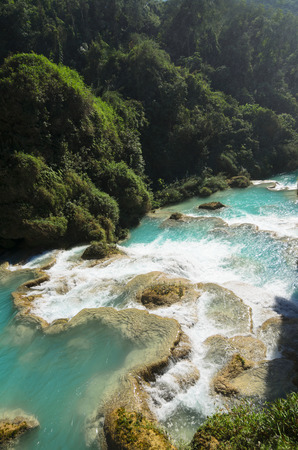 downstream: Downstream of a powerful river with turquoise pools surronded by tropical forest Stock Photo