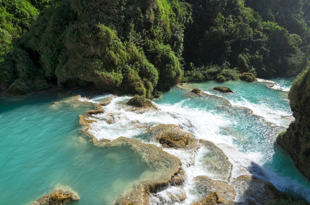 downstream: Downstream of a river with turquoise water between rocky shores