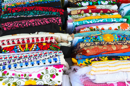 purl: Folded colorful authentic Mexican womens shirts