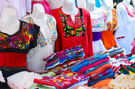 blouses: Colorful authentic Mexican women blouses on mannequins at the market Stock Photo