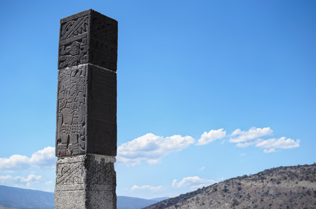 Ancient Toltec column with writing on it Stock Photo