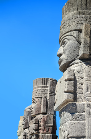 Atlantean figures against blue sky at the archaeological sight in Tula Stock Photo - 56482256