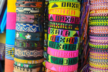 wristbands: Numerous colorful wristbands with Oaxaca sight for sale at craft market