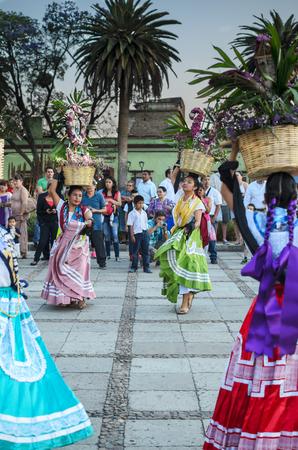 oaxaca: OAXACA DE JUARES, MEXICO, 09 APRIL 2016: Mexican young dancers in traditiona Oaxaca dresses at the festival. Editorial