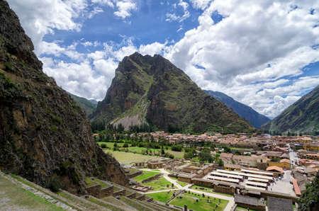 Stunning view to Ollantaytambo Inca ruins and town behind Stock Photo