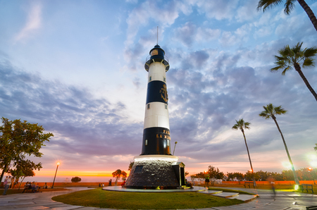 LIMA, PERU, 21 FEBRUARY 2017: view to light house at the sunset in Miraflores district Editorial
