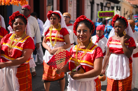 SAN CRISTOBAL DE LAS CASAS, MEXICO, 13 DECEMBER 2015: Women in traditional Chiapas dress walking outdoors