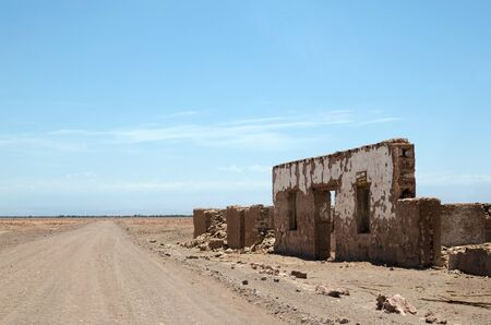 pica: Ruins of mining town in the desert