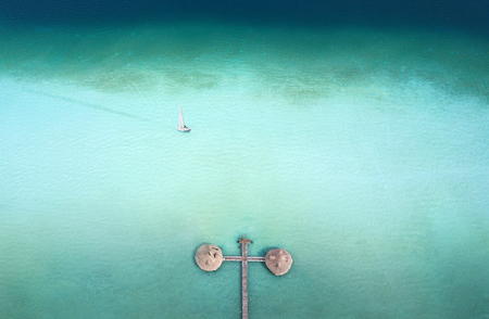 Sailing boat and palapa pier from above - shot from the drone Stock Photo