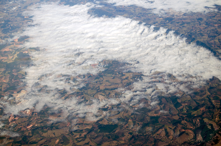 Aerial view to hills and clouds over them Stock Photo