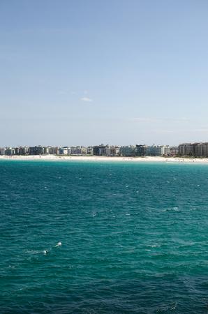 Sky,city, sea - view to Cabo Frio across the beach under blue sky Reklamní fotografie