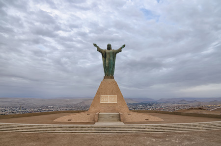 ARICA, CHILE, 2017-01-26: statue of Jesus Christ overlooking Arica city in Chilean desert