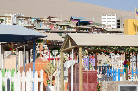 ARICA, CHILE, 2017-01-25: colorful cemetery in the desert - closeup featuring some of the graves