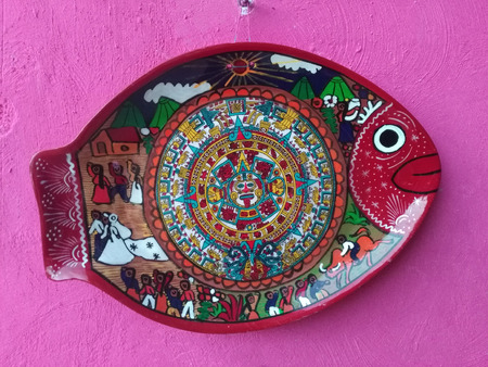 VALLADOLID, MEXICO, 02 JAN 2019: colorful decorative plate in shape of fish with Mayan and Mexican motives
