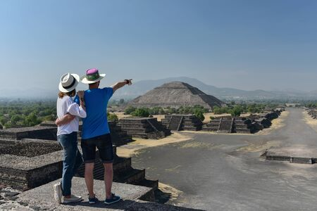 Couple overlooking Pyramid of Sun in Teotihuacan