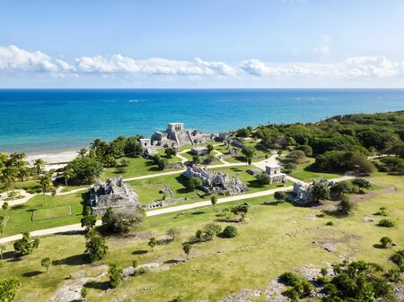 Aerial view of Tulum ruins. Ancient city of Maya at the coast of Caribbean sea with turquoise blue waters. No tourists, no people in the frame, authentic look of historical landmark. Beautiful travel destination in Mexico.