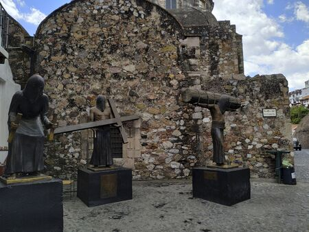 TAXCO, MEXICO, 20 MARCH 2019:  statues in front of temple in downtown of Taxco