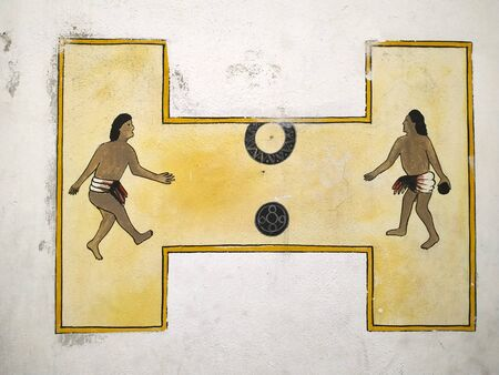 TAXCO, MEXICO, 19 MARCH 2019: Mayan ballgame pictured in a graffity on a white wall