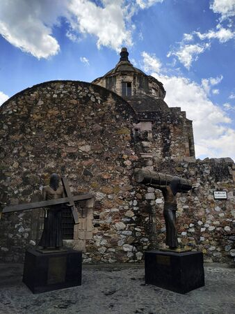 TAXCO, MEXICO, 20 MARCH 2019:  statues with Christian artifacts in front of temple in downtown of Taxco