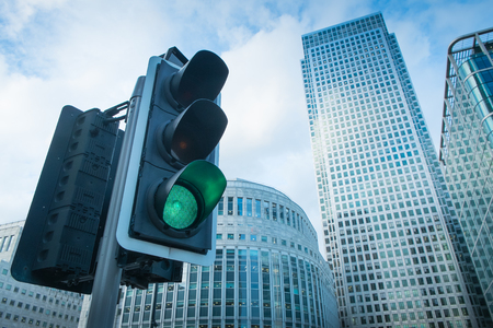 Green, Yellow and Red Traffic Light in the London city photo
