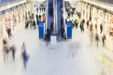 London Train Tube station Blur people movement in rush hour,\ at King\