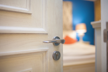 open house: half-open door of a bedroom Stock Photo