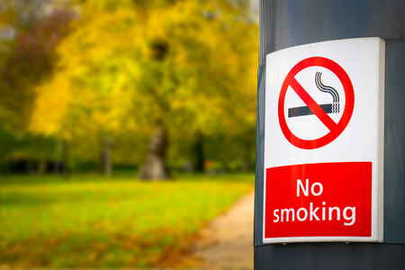 no smoking board & sign in the park photo