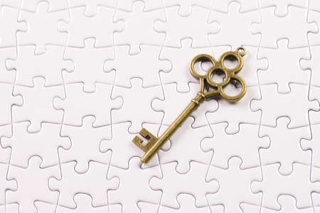 Jigsaw Puzzle with Antique  Key, business concept