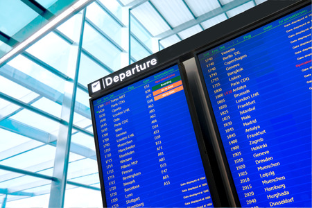 departure board: Flight information, arrival and departure board at the airport