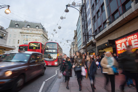 west end: LONDON, ENGLAND - DECEMBER 30, 2014: Oxford street on sale season after Christmas. This street is a major shopping street of London.