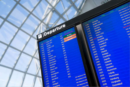 departure board: Flight, arrival and departure  board at the airport Editorial