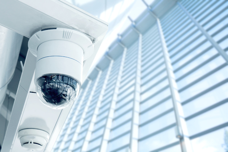 Security, CCTV camera in the office building Imagens