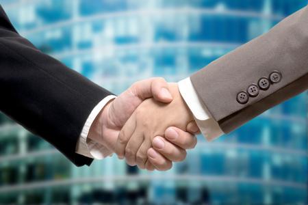 business buildings: Business deal, handshake