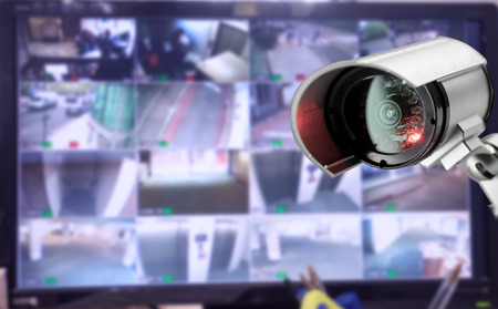 camera: CCTV security camera monitor in office building Stock Photo