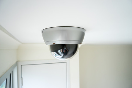 security monitor: CCTV security camera monitor in office building Stock Photo