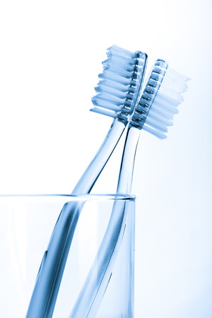 tooth brush: tooth brush in glass Isolated on white background