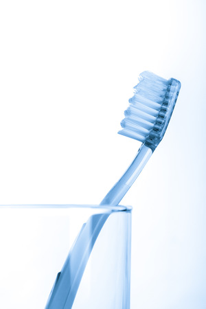 brush in: tooth brush in glass Isolated on white background