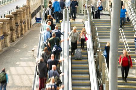 Train Tube station Blur people movement in rush hour at Edinburgh, Scotland, UK photo