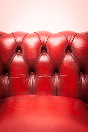 red sofa: Red genuine leather Sofa for background