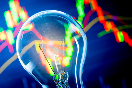 investment ideas: Business success with stock graph and light bulb