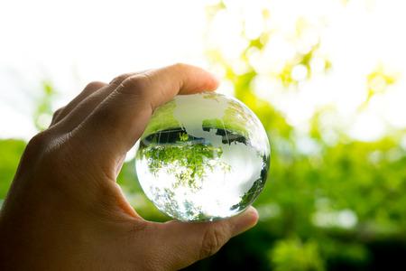 glass globe: Green & Eco environment, glass globe in the garden Stock Photo