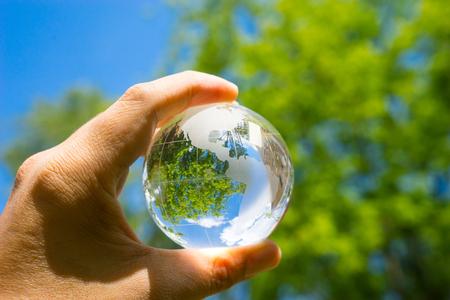 glass sphere: Green & Eco environment, glass globe in the garden Stock Photo